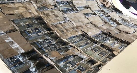 بالصور.. إحباط تهريب 9 آلاف زجاجة خمر ضمن إرسالية أنابيب خرسانية